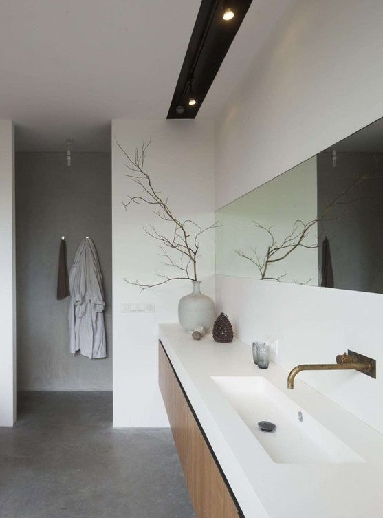 Salle de bain avec béton ciré